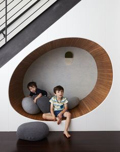 An area underneath a cellar staircase becomes an egg-shaped play area in Tang's hands. The white oak–lined nook features Abigail Edwards wallpaper with a subtle wave pattern. #dwell #howtodesignakidsroom #kidsroom #moderndesign #howto #diy #designtips Under Stairs Nook, Zen Space, Space Architecture, Modern Kids, Design Firms, Townhouse, Bean Bag Chair, Modern Design, Scale