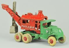 """HUBLEY PANAMA DIGGER ON MACK TRUCK CHASSIS  Cast iron, large scale toy, painted in green Mack cab w/red """"Panama"""" body and nickel cast iron shovel, dual rubber tires on rear, house swivels on open frame"""