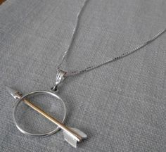 "Hancrafted ""Arrow Through the Bullseye"" necklace.  Silver and gold accented pendant, approximately 1.5"" wide.  Chain included.  By Peter Wynn (silvercanyonjewelry.etsy.com).  18"" sterling silver box chain.  Pendant:  sterling silver, 14K gold-filled.  ""Arrow Through Bullseye"" earrings avail..."