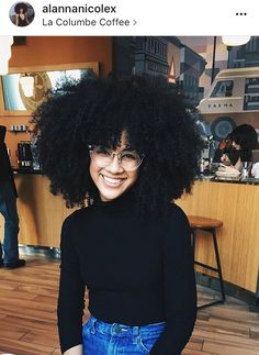 Alanna Doherty big curly natural Afro hair glasses