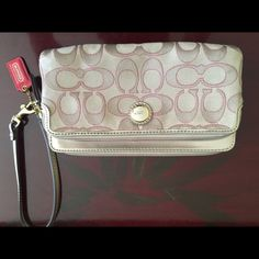 Coach wallet. Authentic In fair condition. Khaki with hot pink stitching. Coach Bags Wallets