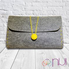 Hey, I found this really awesome Etsy listing at https://www.etsy.com/listing/156491625/felt-clutch-bag-hand-bag-grey-yellow