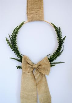 We're big fans of easy DIY wreaths here at burlap+blue. This embroidery hoop and boxwood wreath is a nod to spring, but would easily work year-round. Use any faux greenery or fabric/ribb…