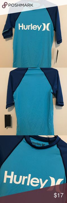 Hurley Rash guard /Swim shirt Boys Size Large New with tags Rash guard swim shirt in boys size large  As with all swim shirts, this is a snug fit large. (not loose fit) Hurley Swim Rashguards