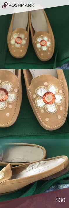 Cole Haan slip ons, 7.5b Tan Cole Haans with sequin flower in red, white and gold. Suede leather inside and out, leather soles. Comfort inside. Bottom and inside marked, outside pretty good. 7.5 Cole Haan Shoes Flats & Loafers