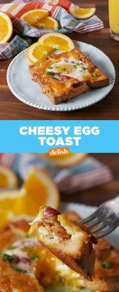 Cheesy Egg Toast is stupid easy to make. Get the recipe at Delish.com. #cheesy #egg #toast #breakfast #brunch #delish #recipe #easyrecipe