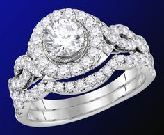 Scintillating 3/4-carat EGL-certified center stone is caressed by a halo of pavé diamonds in this fashionable bridal set from GND's Enchanting Bliss collection. The rings are crafted in 14-karat white gold and boast a total weight of 2 carats. Be sure to check out the full line here...  http://www.jewelrysupercenter.com/index.php?file=productlist&icatid=778  #enchantingblissbygnd #engagement