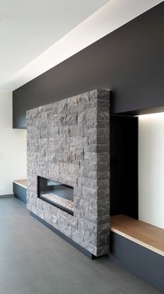 Corner Fireplace Ideas - Warming up your room with some corner fireplace ideas for your house. Some people might not feel comfortable about placing the fireplace area in the corner because it's not the most common design of a fireplace. Home Fireplace, Fireplace Design, Fireplace Ideas, Home Living Room, Living Room Designs, Moderne Lofts, Natural Stone Fireplaces, Modern Stone Fireplace, Modern Fireplaces