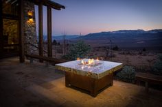 Garden Amusing Square Brown Tiles And Brown Wooden Varnished Outdoor Propane Fire Pits As Well As Concrete Floor Also Clear Glass Above Fire Pits Gorgeous Outdoor Propane Fire Pits Decor Ideas