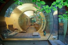 Sound design: A circular-shaped room extends from one end of the  Wilkinson residence, a h...