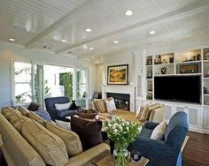 Family room for the cottage. The ceiling is beautiful: love the pot lights, and skinny beams.