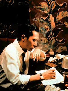 In the Mood for Love - Tony Leung's suited-up writer look. Yeaaaah.