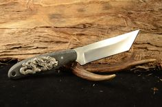 """Blade length 4 1/4"""" with bead blast finish -  overall length of 8""""  Handle is Micarta.  Made with d2 steel"""
