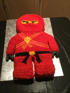 Ninjago cake. Made using star icing tip and medallion made using melted chocolate,