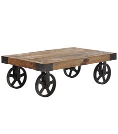 Give your living room a rustic accent with this vintage styled coffee table. The table features distressed surfaces for a warm, worn look. Black wrought iron frame adds character and charm to this unique piece.