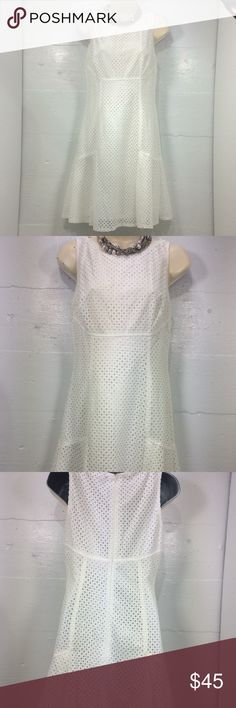 """Chaps Cream Eyelet Dress Beautiful cream colored fully lined sleeveless eyelet A-line dress. Elegant pleats at the bottom complete this elegant look. P-P 17"""" S-H 36"""" Chaps Dresses"""
