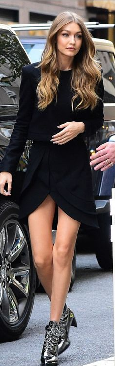Who made  Gigi Hadid's black wrap dress and silver boots?