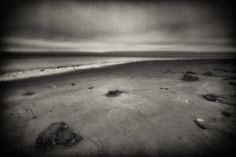 """Fine Art Photography, Black and White Photography, Beach Photography, Pacific Northwest, Washington State, Puget Sound, Fort Flagler State Park, beach, rocks, clouds, water, moody, grainy, zen. """"Dusk at Fort Flagler"""" Located at the north end of Marrowstone Island, Fort Flagler was constructed during the last decade of the 1900s as part of a network of forts designed to protect the shipyards in Bremerton and ports of Seattle and Tacoma. The fort was decommissioned after World War II and…"""