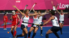 Georgie Twigg (L) of Great Britain celebrates scoring their fourth goal during the women's Hockey match between Great Britain and Republic of Korea on day 4 of the London 2012 Olympic Games at Riverbank Arena