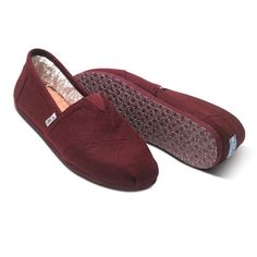 TOMS Burgundy Woolen Classics These are Men's size 8 so they will fit more like a women's size 9. This is the wool version of the original TOMS shoe that started it all. Styled like the traditional Argentinian alpargata, this slip-on pair boasts the classic TOMS toe-stitch, elastic V goring for easy on and off, and a comfortable, cushioned suede footbed. TOMS Shoes