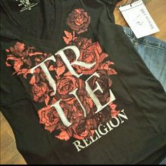 True Religion Ladies Tee ***ONE HOUR SALE *** True Religion  black ladies tee with red glitter. The red glitter highlights the brand, giving it that POP of color that is sure to make a fashion statement! True Religion Tops Tees - Short Sleeve