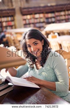 A shot of an asian student studying in a library by arek_malang, via ShutterStock