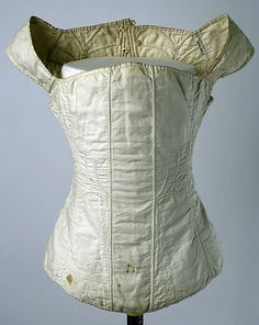 Cotton corset 1810s–20s, American - in the Metropolitan Museum of Art costume collections. (Cording on the sides and back.)