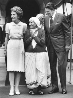 REMEMBERING MOTHER THERESA.  President Ronald Reagan and First Lady Nancy Reagan stand with the great humanitarian Mother Theresa at the White House.