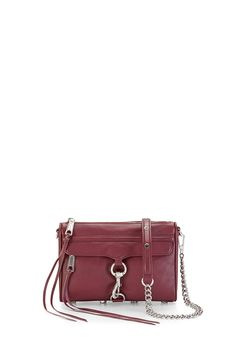 Mini M.A.C. Crossbody - A petite take on Rebecca's classic M.A.C. clutch, this handbag is much roomier than it looks. It's big enough to fit your phone, keys, wallet and makeup essentials, but sleek enough so that it won't weigh you down. Wear it on your shoulder or crossbody with the adjustable chain strap.