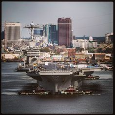 "The aircraft carrier USS Harry S. Truman transits the Elizabeth River en route to Norfolk Naval Shipyard. Modern aircraft carriers are so large that they are sometimes referred to as ""floating cities."" #AmericasNavy #USNavy #Navy navy.com"