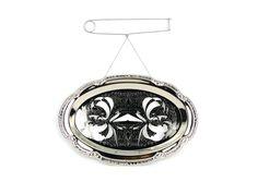 Melissa Cameron. Brooch: Mirror Brooch. Serving dish (chrome plated mild steel) titanium, stainless steel.