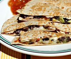 Chicken, black beans, avocado and cheese quesadillas. Using whole wheat tortillas