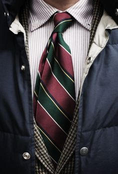 Grey houndstooth jacket, white shirt with blue dress stripes, red tie with green, yellow & navy stripes