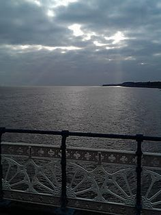 Sun peeping through the clouds in winter - Penarth Pier Seaside Resort, South Wales, Capital City, Wonders Of The World, Britain, Entryway Tables, Beautiful Places, Clouds, Adventure