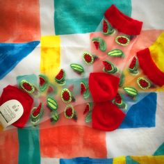 Made from sturdy transparent material, socks have red ankle bands, heels and toes and a repeat embroidered pattern watermelon slices all over. Will fit up to a size EU 39.