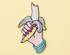 ***LIMITED EDITION ***  This is a BANANA enamel pin! Made of shiny gold brass, pink, white and turquoise enamels, and a butterfly hook.  It is perfect for pinning on your jean jacket or your tote bag!  This pin measures 3 x 2 cm.  The automatic shipping profile does not include Track. Please send me a convo if youd like your item traceable, it would cost 5,80€.  Please dont hesitate to contact me if you have any questions! Thanks