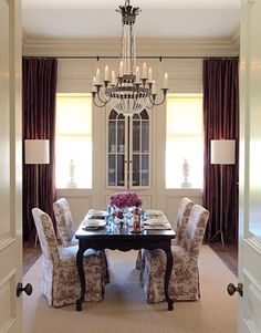 An iron-and-crystal chandelier from Niermann Weeks is the star of this dining room.