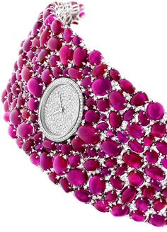 DeLaneau's Haute Couture Joaillerie Grace Rubis White Gold Watch, set with more than 600 Diamonds and 214 Cabochon-cut Rubies. ❤ http://amzn.to/2srHarv