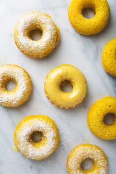 20 minute Turmeric Lemon Donuts covered in sweet glaze and dusted with finely shredded coconut. The flavor is like lemon meringue meets golden milk! Honey Recipes, Desert Recipes, Baking Recipes, Baked Donut Recipes, Baked Donuts, Vegan Doughnuts, Just Donuts, Fancy Donuts, Opening A Bakery