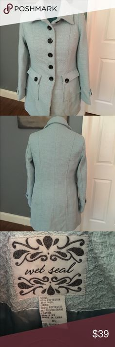 Light blue petty coat. Tweed textured fabric Light blue. Black buttons. Wet Seal XL. Material is poly/wool blend. Lined in matching poly fabric. Surprisingly warm but not too heavy. I didn't not see any pulls in the fabric but if found they are easy to snip out. Wet Seal Jackets & Coats Pea Coats