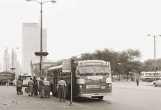 Black folks boarding the #3 bus on Michigan Ave in 1958.  Illinois Central entrance in background to the left.