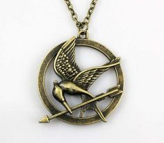 SALE--The Hunger Games pendant ,Inspired Mockingjay Necklace-Bronze--double sides from sweethearteverybody on Etsy. Hunger Games Mockingjay, Hunger Games Trilogy, Book Jewelry, Katniss Everdeen, Chokers, Pendant Necklace, Necklace Chain, Pendant Jewelry, Unique Jewelry