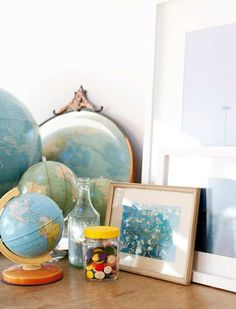 Love globes. Inspiration/reminder for above media center shelving project.