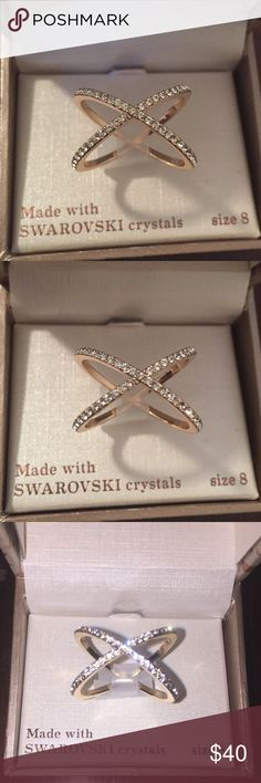 NWT Authentic Swarovski crystal ring 💍 NWT Authentic Swarovski crystal ring 💍 made with real Swarovski crystals size 8 ring. Crossed infinity design. Beautiful and simply stunning 😍 Swarovski Jewelry Rings