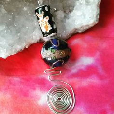 Check out this item in my Etsy shop https://www.etsy.com/listing/251120635/bead-and-spiral-necklace