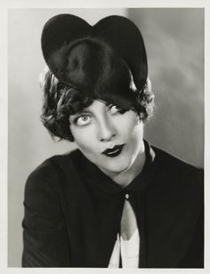 Joan Crawford in a heart-shaped hat// this is too awesome for words.