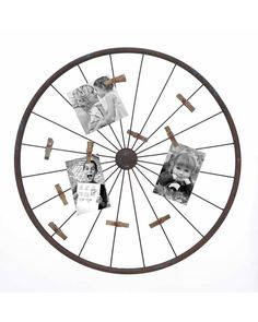 Vintage Iron Wagon Wheel Wall Photo Holder - makes a clever way to keep your photos front and center. Ingenious design features 20 wheel spokes capable of holding all your treasured memories. Iron alloy rods wrapped with rusted iron wheel surface makes for a realistic 19th century wheel, but perfect to display photos of any contemporary era. Hang it on the wall of the family room. Or even lean it against the wall on your fireplace mantel.