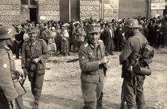 September 1939. German soldiers guarding a group of Jews in Sanok, Poland. The Germans arrived on September 9, 1939, and began a regime of persecution. A Judenrat was established at the end of 1939. By 1941, with refugees pouring in, the ghetto was packed with 10,000-13,000 Jews. By February 1943, all the Jews from Sanok had been deported to Belzec Death Camp.