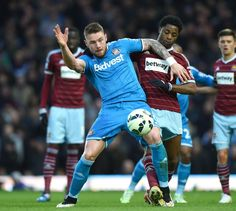 Alex Song vies with Connor Wickham