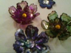 homemade flowers using recycled plastic, alcohol inks, stamps,. They look like glass, very fun and easy to make...